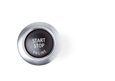 Button start and turn off the ignition of the car engine close-up on the dashboard, electric key, pressing drives the motor vehicle of modern design on white isolated background.
