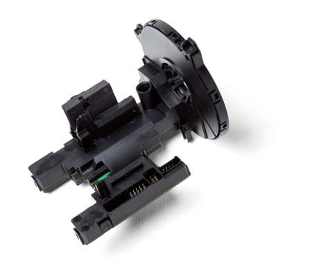 steering angle sensor disassembled on a white isolated background, spare part for car repair or for sale at junk yard.