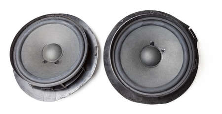 Pair of speakers of an acoustic system - an audio for playing music in a car interior on a white isolated background in a photo studio. Spare parts for auto repair in a workshop or for sale for tuning