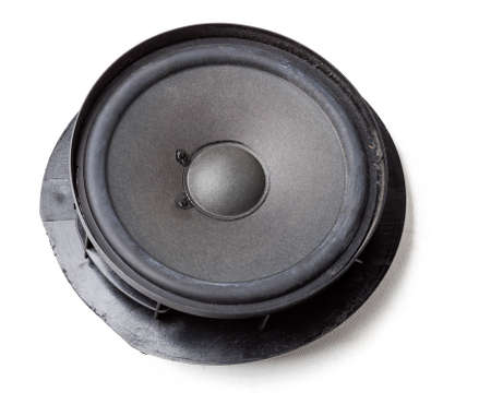 speaker of an acoustic system - an audio for playing music in a car interior on a white isolated background in a photo studio. Spare parts for auto repair in a workshop or for sale for tuning