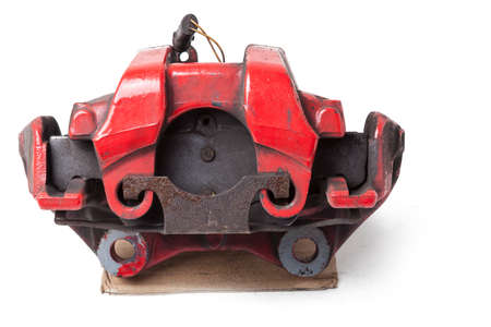 Red metal brake caliper on a white background in a photo studio for replacement during the repair of the chassis or for a catalog of spare parts for sale on auto parsing. Stok Fotoğraf