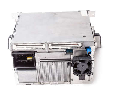 Metal control unit or compact computer on a white isolated background is the connecting center of various subsystems, units and assemblies. Monitoring the state of the moment. Spare part 写真素材