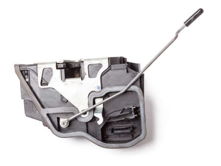 Detail of a car spare part made of black plastic and metal - door lock separately isolated on a white background. Repair in a car workshop, equipment for sale.