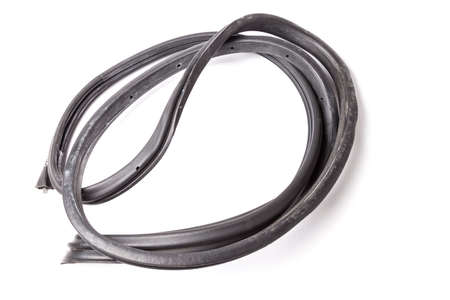 Rolled up black rubber sealant for elements of the car body, doors or trunk, for noise insulation, thermal and sound, preventing heat loss in the car interior. Sealing gasket for repair in a workshop.