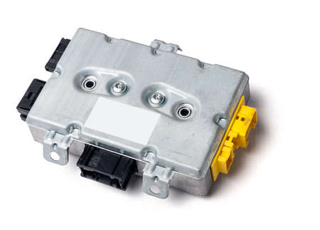 Metal car engine control unit with metal elements on a white isolated background is the connecting center of various subsystems, units and assemblies. Monitoring the state of the moment. Spare part