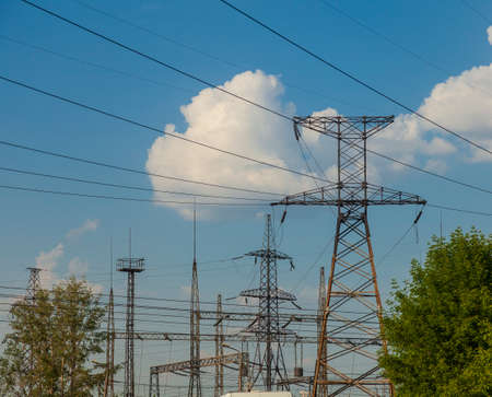 Towers with power lines along which wires are stretched with the transmission of electricity from power plants over long distances.