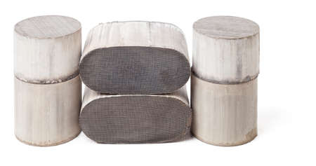 Six round and oval ceramic catalysts containing platinum, palladium and rhodium on a black background. Processing and acceptance of non-ferrous metals.