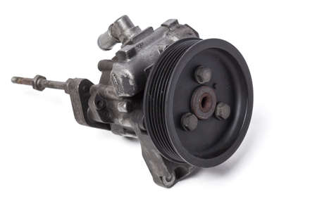 hydraulic power steering pump on a white background engine parts. spare parts catalog from junkyard.
