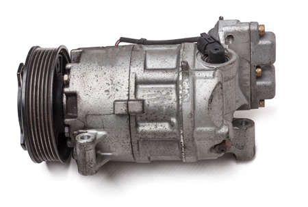 Metal automobile air conditioning compressor for cooling the interior car on white background. The concept of used spare parts for the car engine from junkyard Stok Fotoğraf
