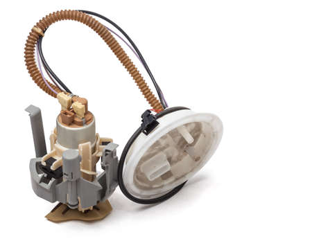 The fuel pump for replacement when repairing a car - injection pump with a fuel level sensor when undergoing scheduled maintenance. A spare part for sale on auto parsing or for a catalog. Stok Fotoğraf