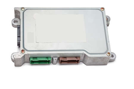 Metallic car engine control unit with plastic elements on a white isolated background is connecting center of various subsystems, units and assemblies. Monitoring the state of the moment. Spare part Stock fotó