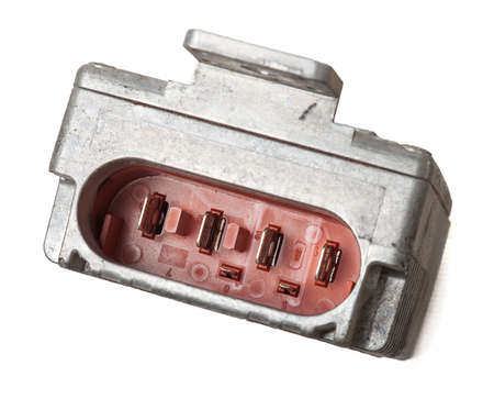 Connector of Metallic car engine control unit with plastic elements on a white isolated background is connecting center of various subsystems, units and assemblies. Monitoring the state of the moment.