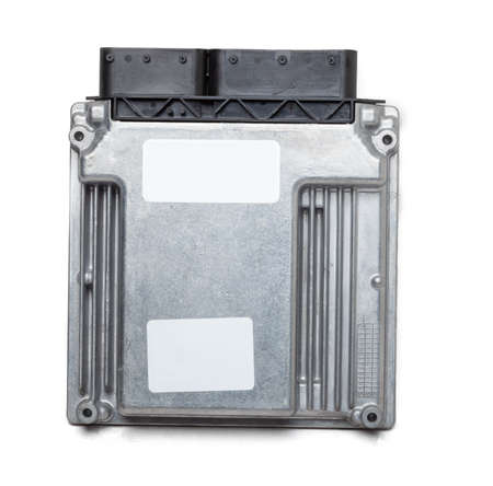 Metallic car engine control unit with plastic elements on a white isolated background is connecting center of various subsystems, units and assemblies. Monitoring the state of the moment. Spare part Stok Fotoğraf