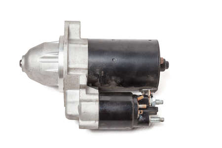 Starter of an internal combustion engine New Spare part for car on a white background. Spare parts catalog.