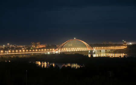 novosibirsk: Bridge illuminated at night in Novosibirsk over the river Stock Photo