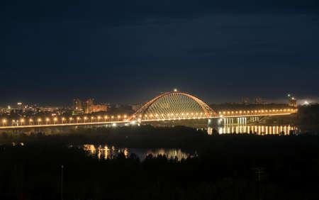 novosibirsk: Bridge illuminated at night in Novosibirsk over the river Stock Photo
