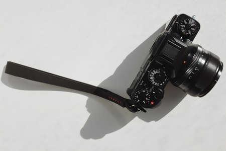 wrist strap: Camera with wrist strap on a white background