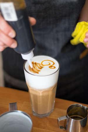 frothy: Hands do drawing on the glass with coffee
