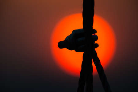 two visions: Black silhouettes on red sunset in summer Stock Photo