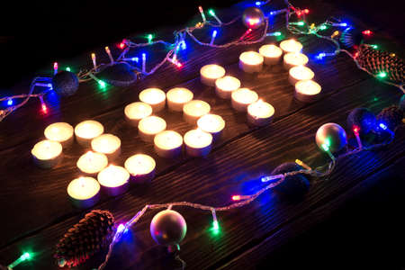 happy new year 2017 written with burning candles christmas lights stock photo picture and royalty free image image 69107969