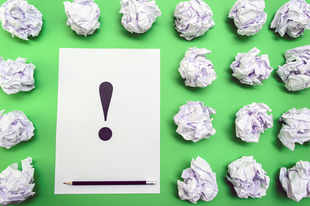 exclamation mark: crumpled paper balls and sheet of paper with exclamation mark