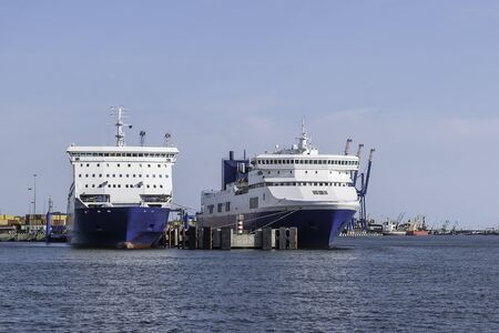 loaded: Two big ships in port. One fully loaded and one empty. Stock Photo