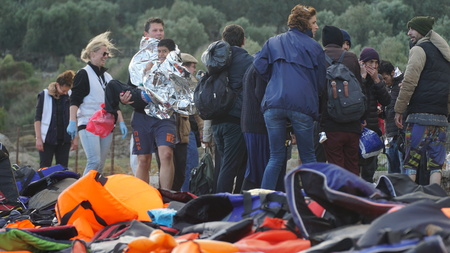 refugees: Refugees had just arrived to the shore Editorial