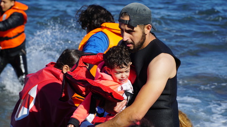 Children are pulled out of the boat. Editorial
