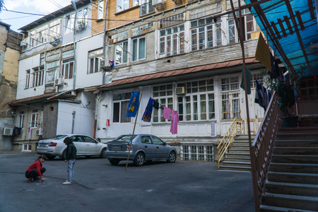 Tbilisi, Georgia-SEP 25, 2016: Typical courtyard in the heart of the old town. Tbilisi, Georgia