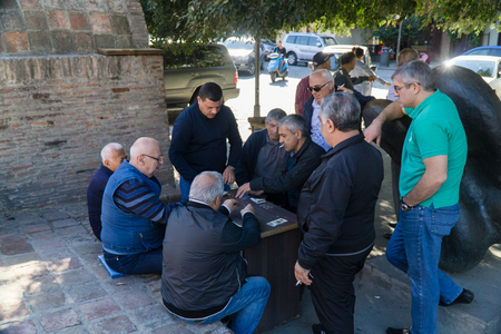 TBILISI, GEORGIA-SEP 25, 2016: Georgian men playing cards for money in the centre of old town.