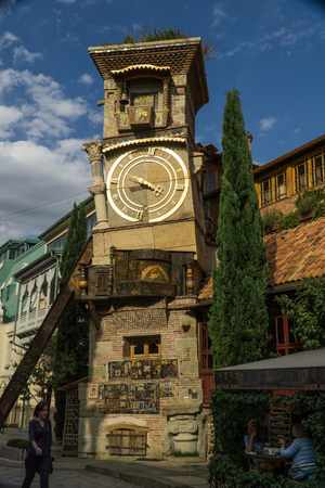TBILISI, GEORGIA - SEP 25, 2016: The leaning clock tower of Rezo Gabriadze Marionette Theatre. Editorial