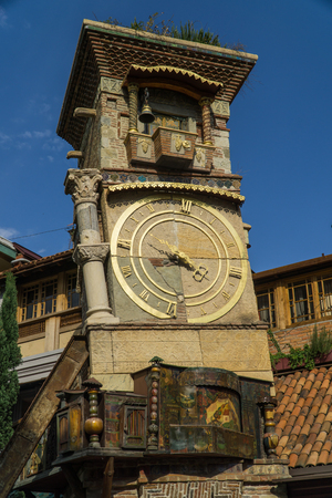 TBILISI, GEORGIA - SEP 25, 2016: The leaning clock tower of Rezo Gabriadze Marionette Theatre. Tbilisi, Georgia. Editorial