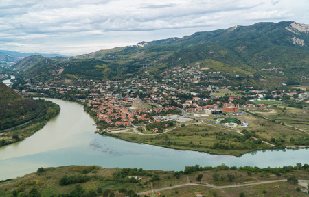 The top view of Mtskheta, ancient city in Georgia at the confluence of the rivers Mtkvari and Aragvi. Standard-Bild