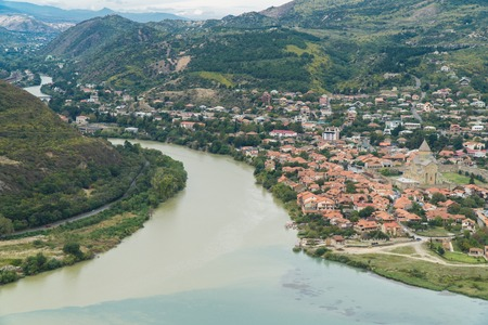 The top view of Mtskheta, ancient city in Georgia at the confluence of the rivers Mtkvari and Aragvi. Banco de Imagens