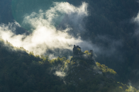 Morning mist around the ruins of a watchtower in the vicinity of Borjomi, Georgia.