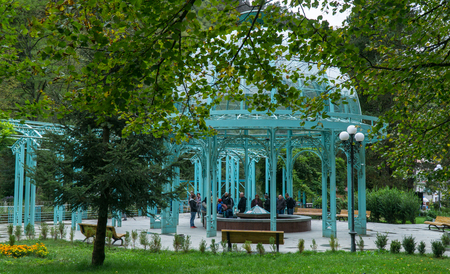 BORJOMI, GEORGIA - SEP 27, 2016: The source of mineral water in city Park Editorial
