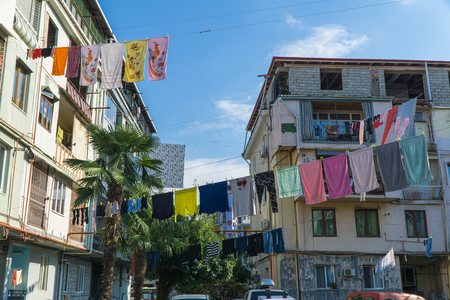 Clothes drying in traditional way on the street of Batumi, Georgia Standard-Bild