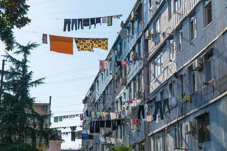 Clothes drying in traditional way on the street of Batumi, Georgia Lizenzfreie Bilder