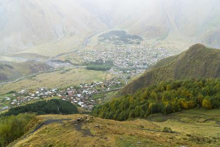 Top view of village Stepantsminda from Gergeti Trinity Church, Georgia