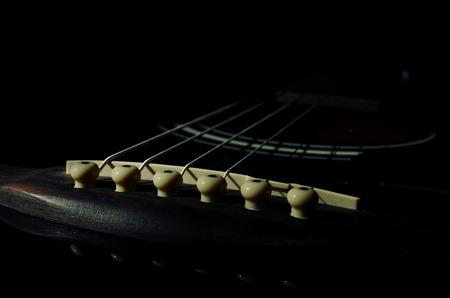 acoustics: guitar on a dark background