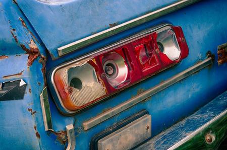 taillight: broken, broken taillight old blue car in the extended dynamic range