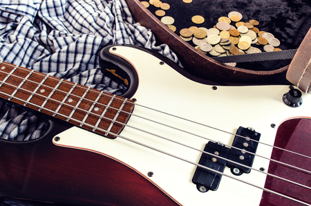 earned: earned a trifle, hard case and bass guitar