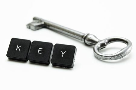 attrition: old shiny key and a button with the keyword