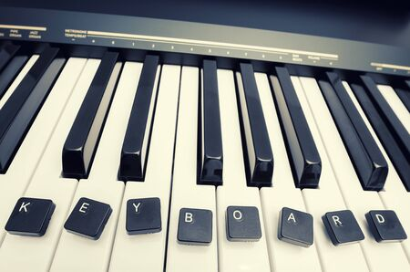 computer keys: piano keyboard, and computer keys with words Stock Photo