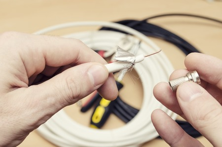 man prepares to install the antenna cable