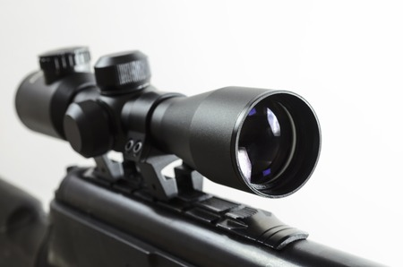 Air rifle with an optical sight on a light background Foto de archivo
