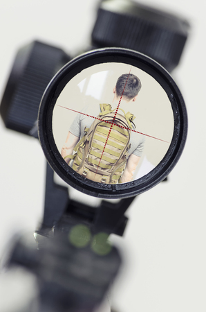 man in the rifle sight aimed at the back Stok Fotoğraf