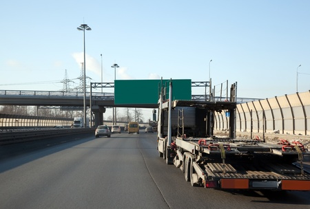 truck with a trailer on the highway. View through the car window. Stock Photo - 9091223