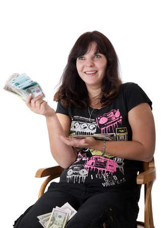 Happy young girl holding a lot of money. Isolated on white background Stock Photo - 9256151