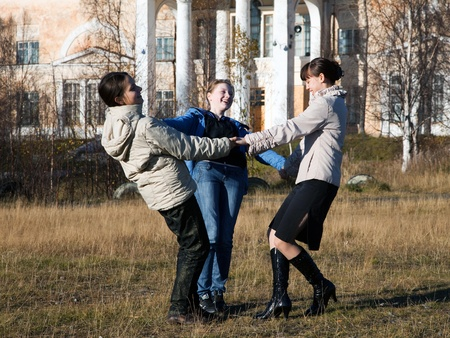 Three girls dancing in the park after school photo